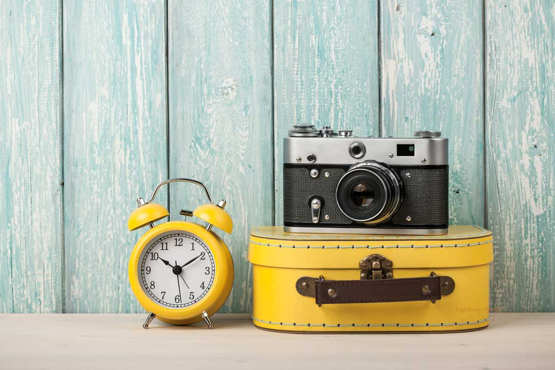 travel-concept-with-suitcase-film-camera-and-3DBSP4U